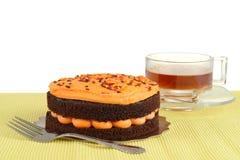Halloween chocolate orange cake with tea Royalty Free Stock Photo