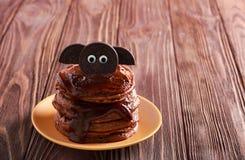 Halloween chocolate pancakes served with glaze Royalty Free Stock Photos