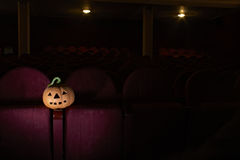 Halloween in cinema. Pumpkin on chair in cinema Stock Image