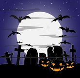 Halloween Cloudy Graveyard. A cloudy halloween graveyard scene at night with bats and pumpkins Royalty Free Stock Image