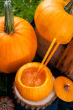 Halloween cocktail in pumpkin. Close up.  Top view. Thanksgiving Day, Party punch. Stock Photo
