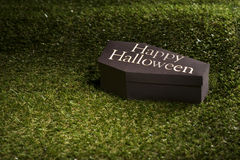 Halloween coffin on lawn Stock Photo