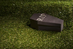 Halloween coffin on lawn Royalty Free Stock Photos