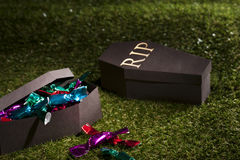 Halloween coffin on lawn with sweets Royalty Free Stock Photo