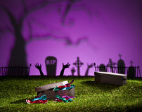 Halloween coffin on lawn with sweets Stock Images