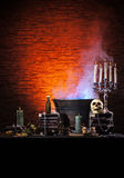 A Halloween composition of candles and a skull Royalty Free Stock Photo