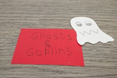 Halloween composition, ghosts and goblins handwritten on a red p stock images