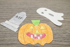 Halloween composition, pumpkin and ghosts on a wood table royalty free stock photo