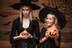 Halloween Concept - beautiful caucasian mother with disappointed feeling with happy little daugther enjoy with Halloween Stock Image
