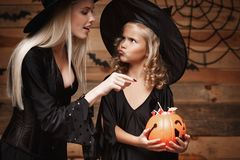 Halloween Concept - beautiful caucasian mother playing with her little daugther enjoy with Halloween candy and sweet Stock Image