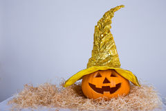 Halloween concept - big pumpkin Jack-O-Lantern in witch hat Stock Photography