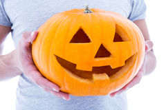 Halloween concept - close up of pumpkin Jack-O-Lantern in male h Stock Photography