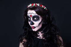 Halloween concept - close up of young woman with skull make up a Stock Image