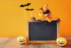 Halloween concept. Cute pumpkin on wooden table Royalty Free Stock Photography