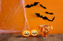 Halloween concept. Cute pumpkins, candy and bats Royalty Free Stock Photography