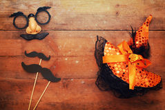 Halloween concept. Funny mustache mask and witch hat Royalty Free Stock Photos