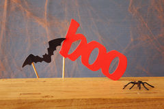 Halloween concept. Funny paper bat and word BOO Stock Photography