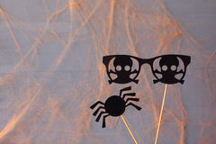 Halloween concept. Funny paper spider and pirate glasses Stock Images