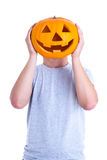 Halloween concept - man covering his face with pumpkin Jack-O-La Stock Photography