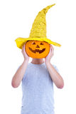 Halloween concept - man covering his face with pumpkin Jack-O-La Stock Image