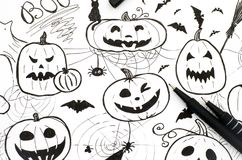 Halloween concept. Markers hand drawing with two pens. Stock Image