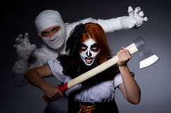 Halloween concept with mummy and woman Royalty Free Stock Photo