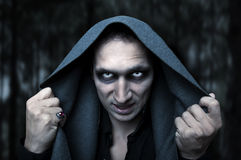 Halloween concept. Mystery evil eyes. Portrait horrible fashion male vampire (demon or evil wizard)  Halloween concept. Mystery white eyes Stock Images
