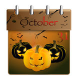 Halloween concept pumpkin and calendar on 31th of October. Halloween concept with shining spooky pumpkin and calendar on 31th of October Royalty Free Stock Photo