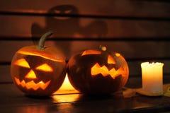 Halloween concept. Halloween pumpkin head jack lantern with shadow of ghost on backgroundoween concept Royalty Free Stock Images