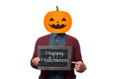 Man with the head of a pumpkin holding chalkboard with text  Happy Halloween. Royalty Free Stock Photos