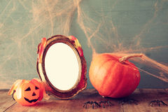 Halloween concept. pumpkin next to blank photo frame Royalty Free Stock Image