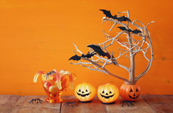 Halloween concept. pumpkins, candy and tree with bats Stock Photography