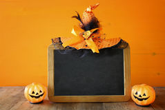 Halloween concept. pumpkins next to blank blackboard Royalty Free Stock Images
