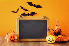 Halloween concept. pumpkins next to blank blackboard Royalty Free Stock Photography