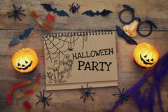 Halloween concept. Pumpkins, spiders, bats and notebook Royalty Free Stock Image