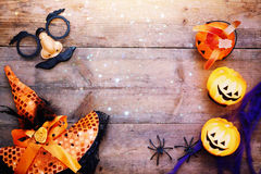 Halloween concept top view. Pumpkins, spiders, witch hat Royalty Free Stock Images