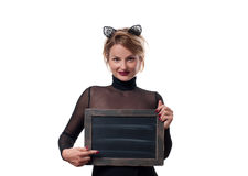 Halloween concept, woman with carnival cat ears holding chalkboard Stock Photos