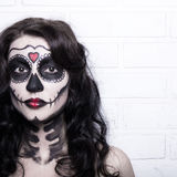 Halloween concept - woman with creative skull make up over white Royalty Free Stock Photos