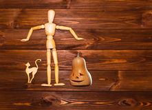 The Halloween concept - wooden man with pumpkin and cat stock photography