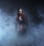 Halloween concept: young and sexy witch. Makes the witchcraft in the dungeon Stock Images