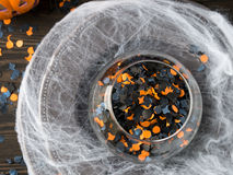 Halloween confetti and spider net on dark background Royalty Free Stock Images