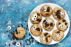Halloween cookie, chocolate american cookies with candy eyes. And chocolate chips, halloween treats for kids stock photography