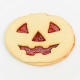 Halloween Cookie with red eyes. Pumpkin cookie with red eyes  on white square background Stock Photography