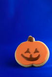 Halloween cookie. Single sugar frosting cookie of Jack o' lantern with blue background Royalty Free Stock Image