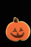 Halloween cookie. Sugar frosting cookie of jack o' lantern with black background Royalty Free Stock Images