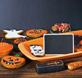 Halloween cookies and blackboard Royalty Free Stock Photography