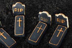 Halloween cookies and chocolate on the graves Stock Image