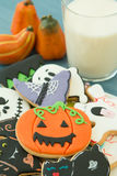 Halloween cookies with different shapes and glass milk Royalty Free Stock Photos