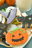 Halloween cookies with different shapes and glass milk Royalty Free Stock Images