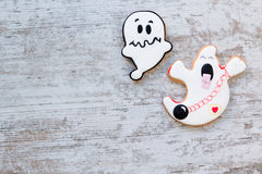 Halloween cookies with ghost shape. Sweet tradition Royalty Free Stock Photos
